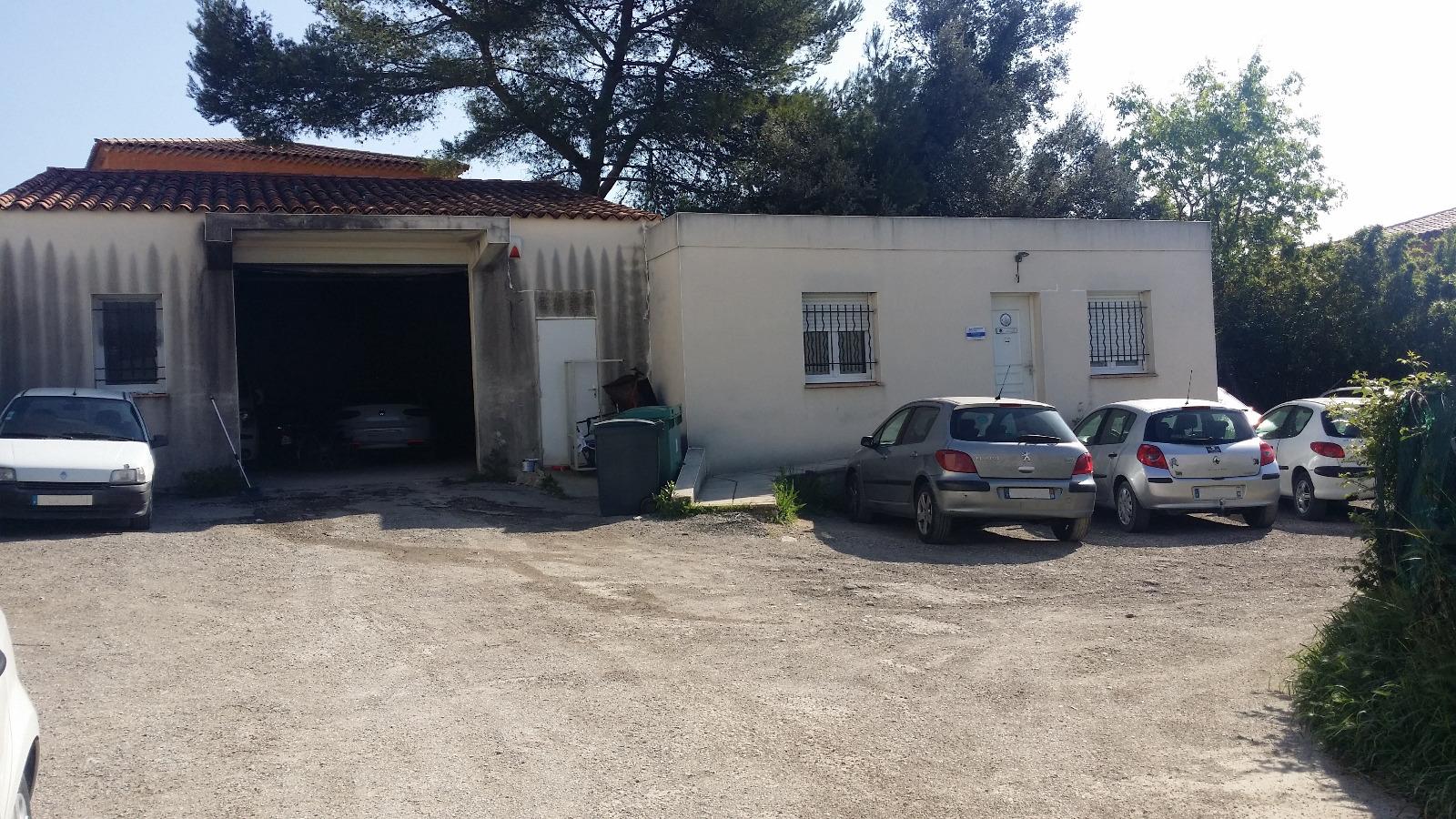 Vente n mes local commercial en zone franche for Garage ad nimes